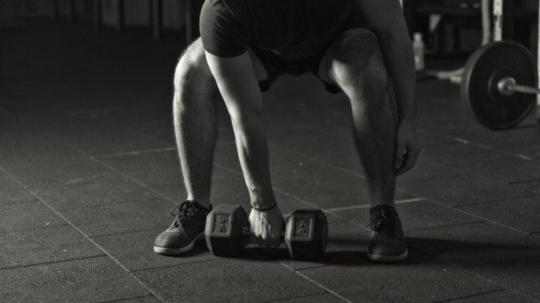 Man snatching dumbbell