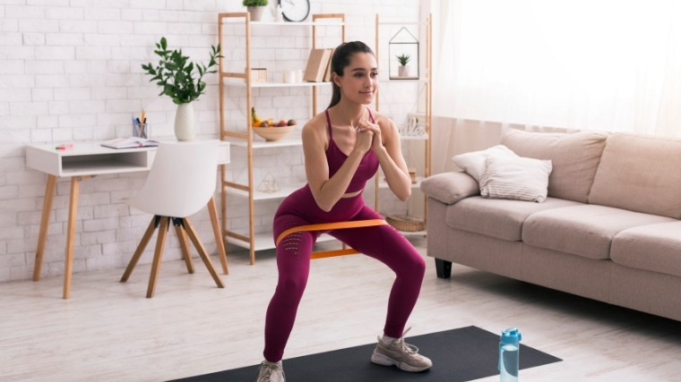 Woman working out with mini band