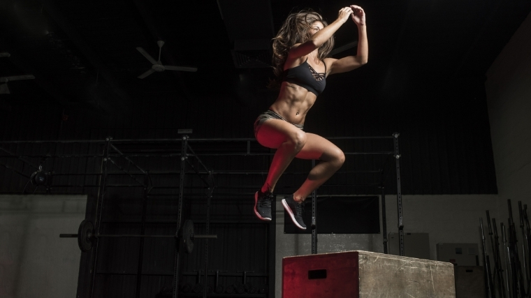 Woman doing box jump