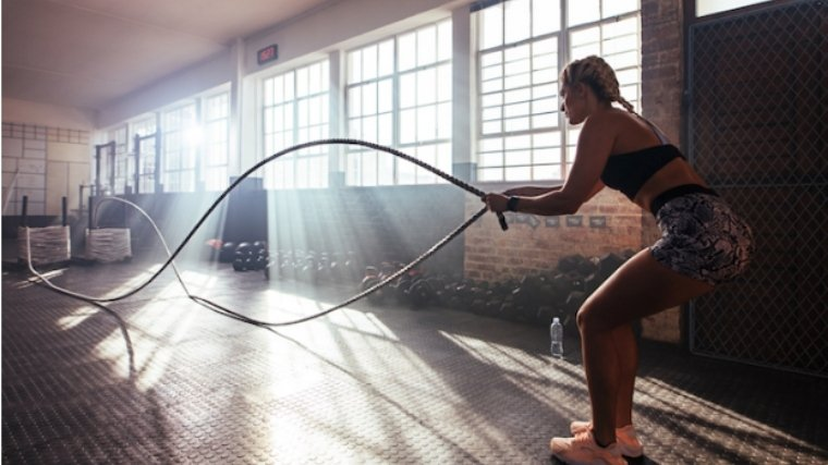 Intermittent Fasting Woman Using Battle Ropes