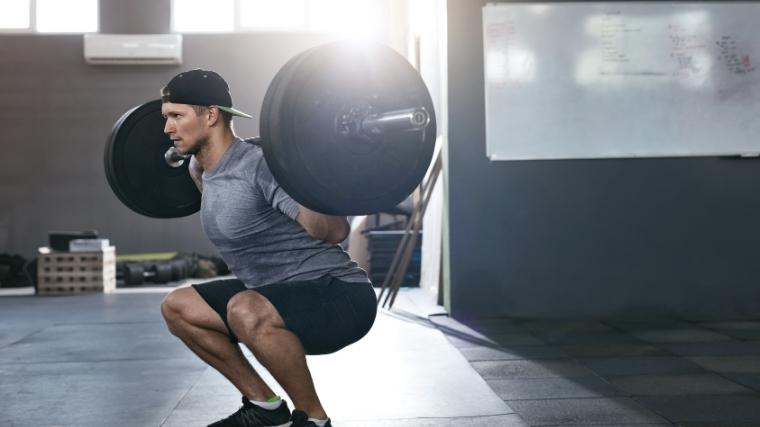 Man doing back squat