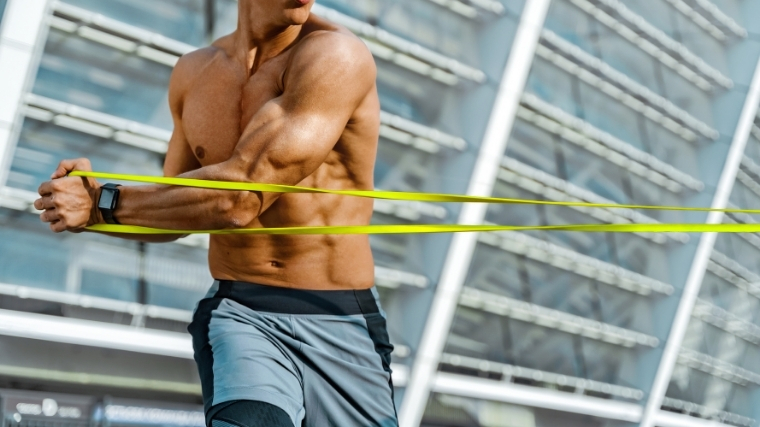 Man rotating with resistance band