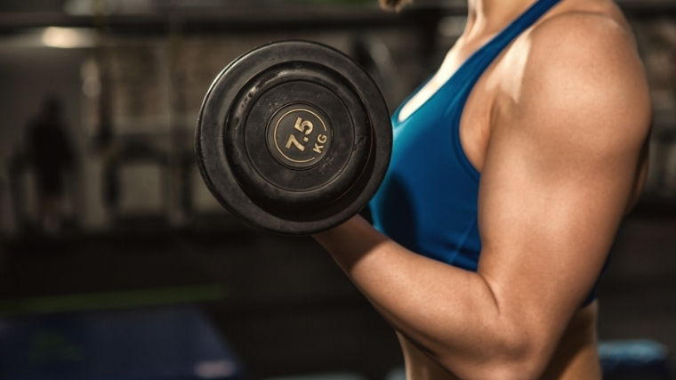 Woman doing dumbbell curl