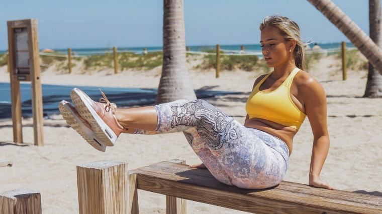 Woman doing abs outside