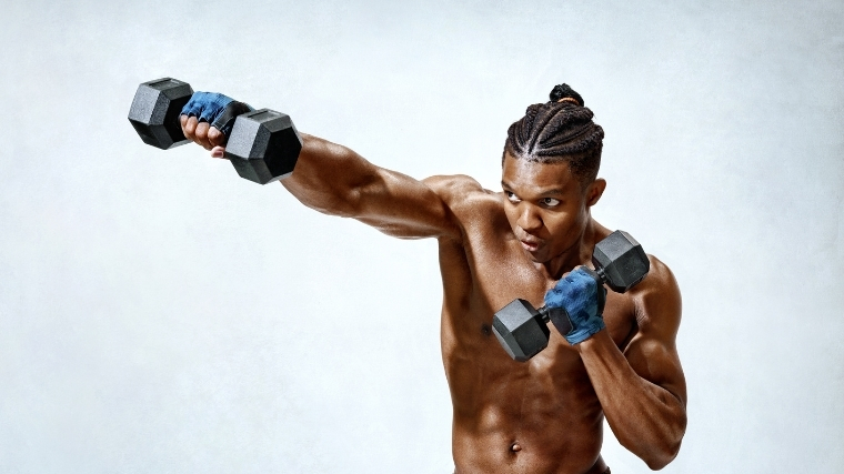 Man doing dumbbell punches