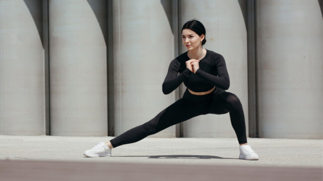 Woman performing lateral lunge