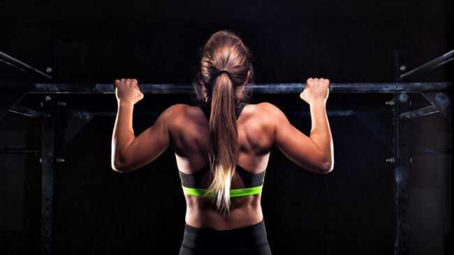 Woman performing a pull-up