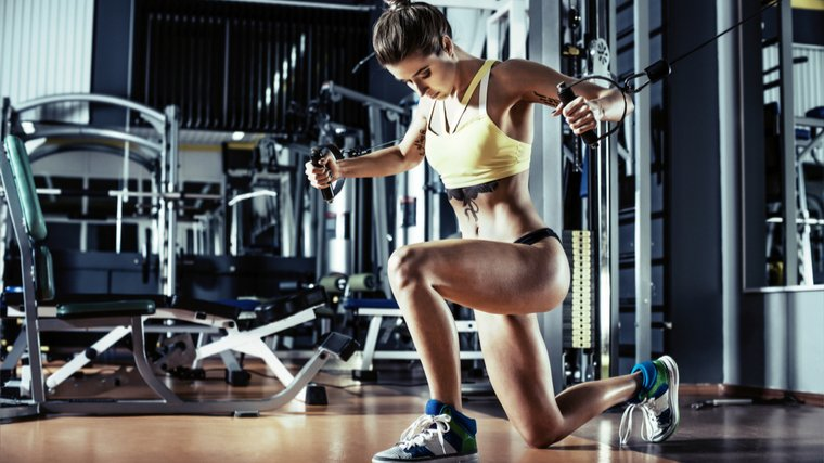 woman doing cable press